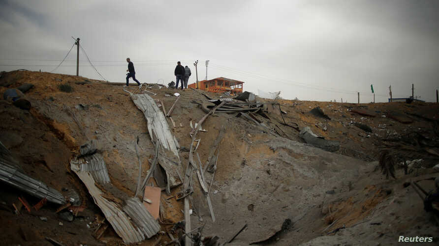 Palestinians inspect the scene of what Gaza police said was an Israeli air strike in the northern Gaza Strip, March 18, 2017.