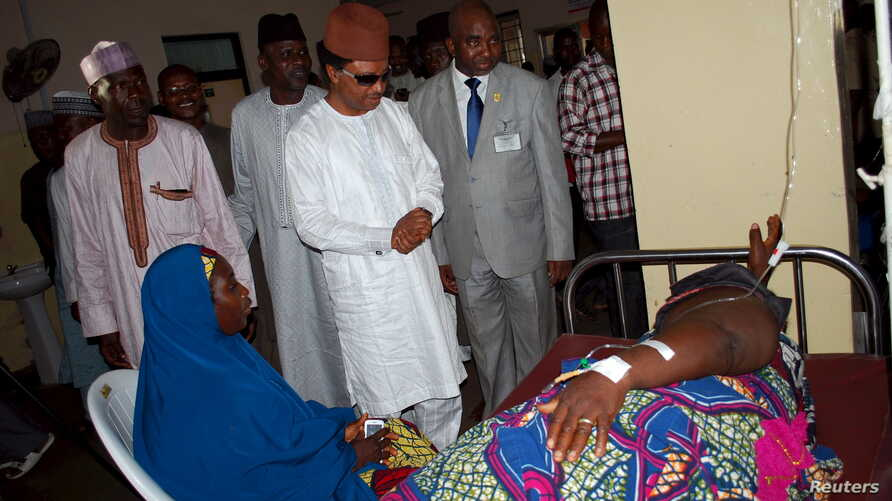 FILE - Senator Shehu Sani visit an injured man in a hospital on the outskirts of the city of Zaria, in Kaduna state, Nigeria, July 8, 2015. Sani's revelation that Nigerian sanators draw a monthly allowance of $38,000 has drawn widespread anger.