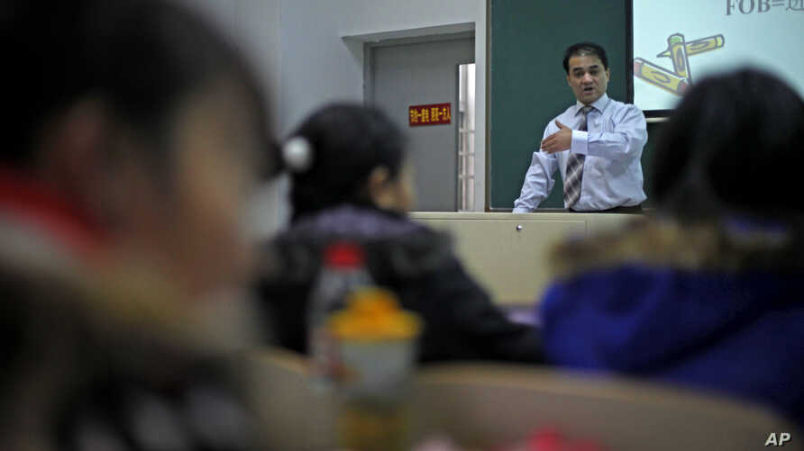 In this Tuesday, Dec. 1, 2009 photo, economist Ilham Tohti, from China's predominantly Muslim Xinjiang region speaks to students at the Central Nationalities University in Beijing, China. His weekly lectures are a kind of high-wire act and he has bee
