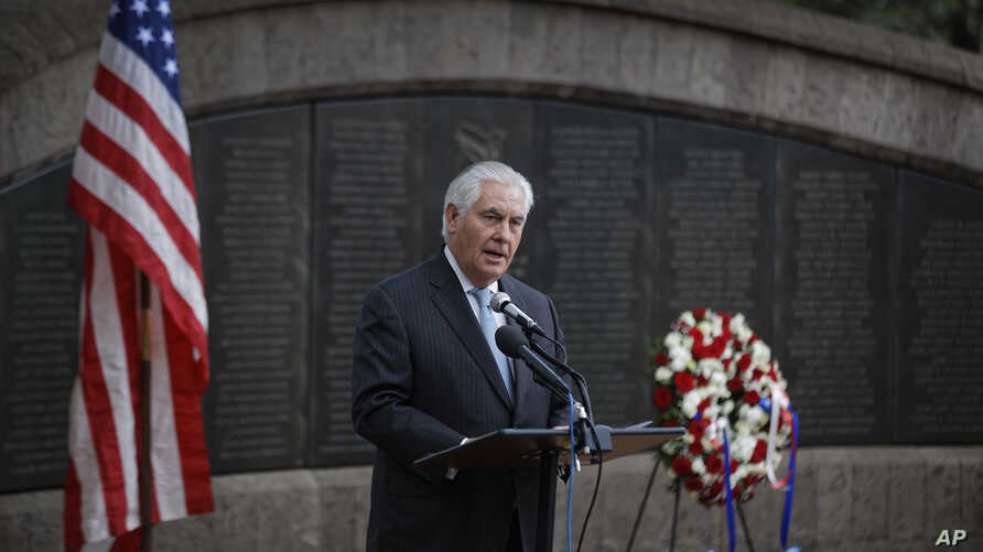 U.S. Secretary of State Rex Tillerson speaks to survivors after laying a wreath during a ceremony at Memorial Park in honor of the victims of the deadly 1998 U.S. Embassy bombing, in Nairobi, Kenya, March 11, 2018.