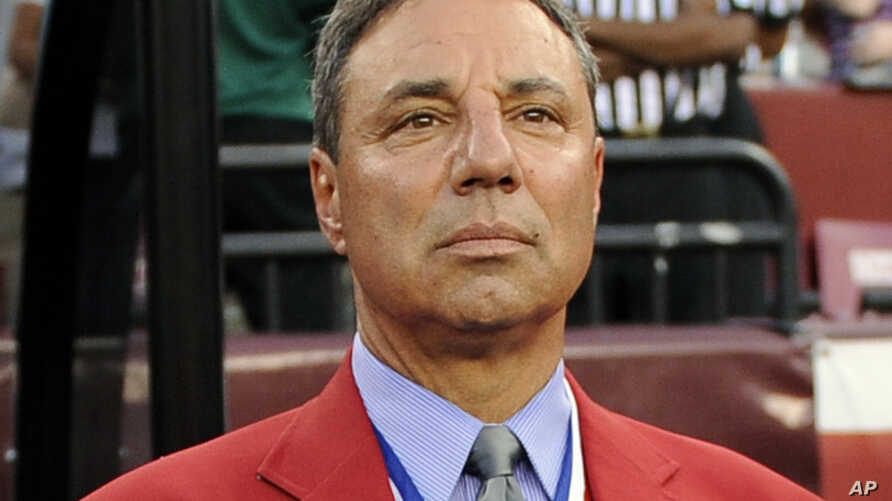 FILE - National Soccer Hall of Famer Tony DiCicco stands on the sidelines before an international friendly soccer match between Brazil and the United States, in Landover, Md., May 30, 2012.  DiCicco, who coached the U.S. to the 1999 Women's World Cup