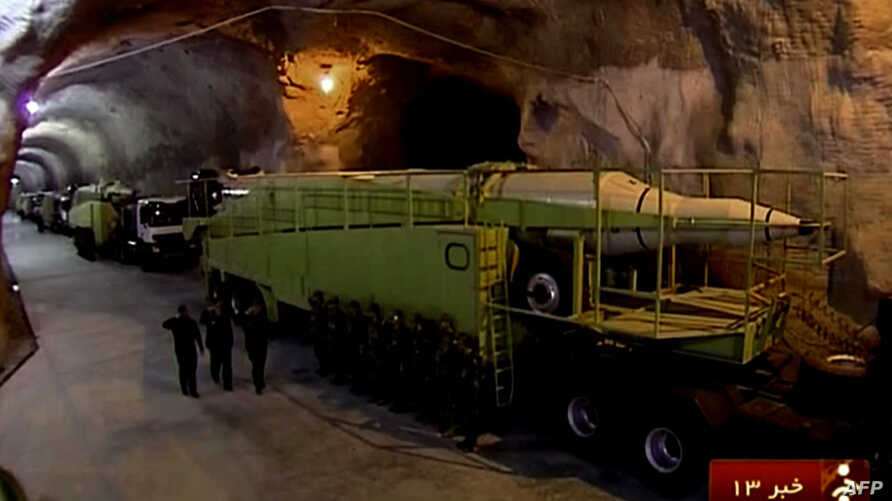 This image taken from an Oct. 14, 2015 broadcast on the Islamic Republic of Iran News Network (IRINN) reportedly shows missile launchers in an underground tunnel at an unknown location in Iran.