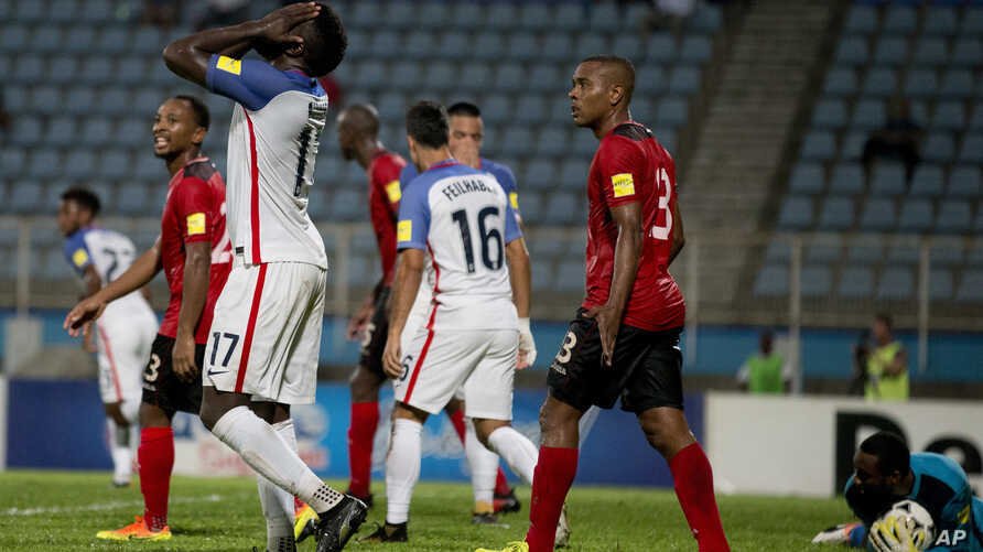 United States' Jozy Altidore, left, reacts after missing a chance to score during a 2018 World Cup qualifying soccer match against Trinidad and Tobago in Couva, Trinidad, Oct. 10, 2017.