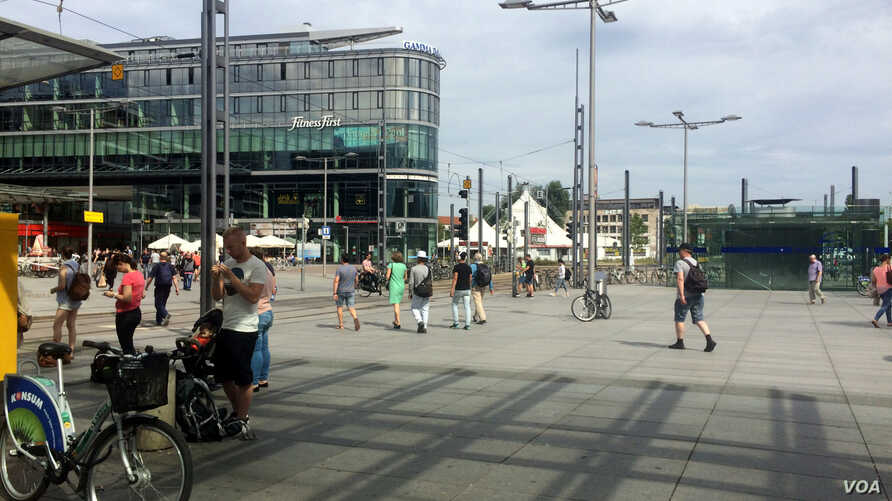 Outside the main train station in Dresden, Germany, refugees say with the long and opaque wait for documentation, they often have little to do but to wait, July 8, 2016.