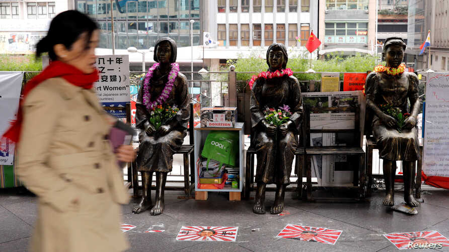 "Statues of ""comfort women"" are placed outside Japan's consulate to commemorate the 80th anniversary of the Nanjing Massacre, in Hong Kong, China, Dec. 13, 2017."