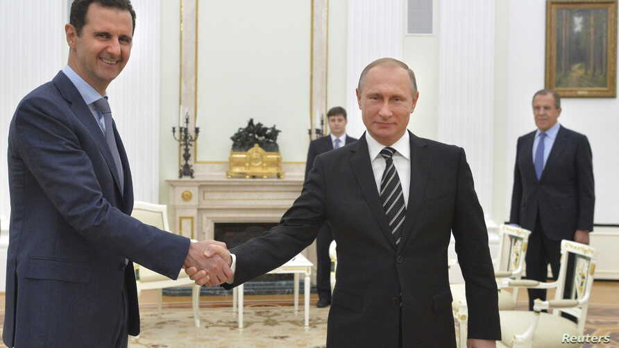Russian President Vladimir Putin (R) shakes hands with Syrian President Bashar al-Assad during a meeting at the Kremlin in Moscow, Russia, October 20, 2015.