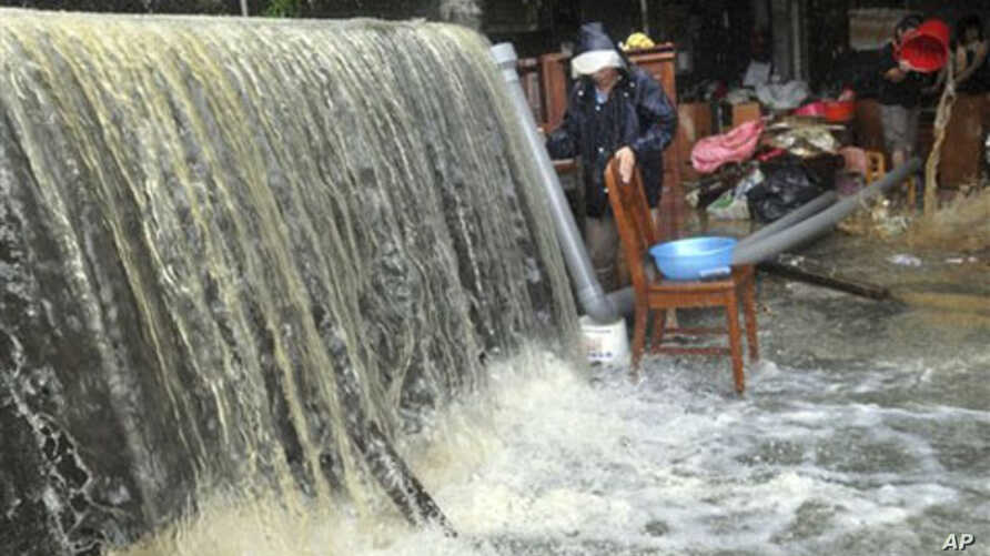 Massive water and flood debris caused by rains from passing Typhoon Megi flow through a residential district in Ilan county, north eastern Taiwan, 22 Oct 2010