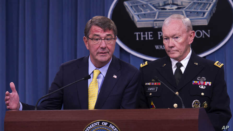 FILE - Defense Secretary Ash Carter is seen briefing reporters at the Pentagon. Behind him is Joint Chiefs Chairman General Martin Dempsey.
