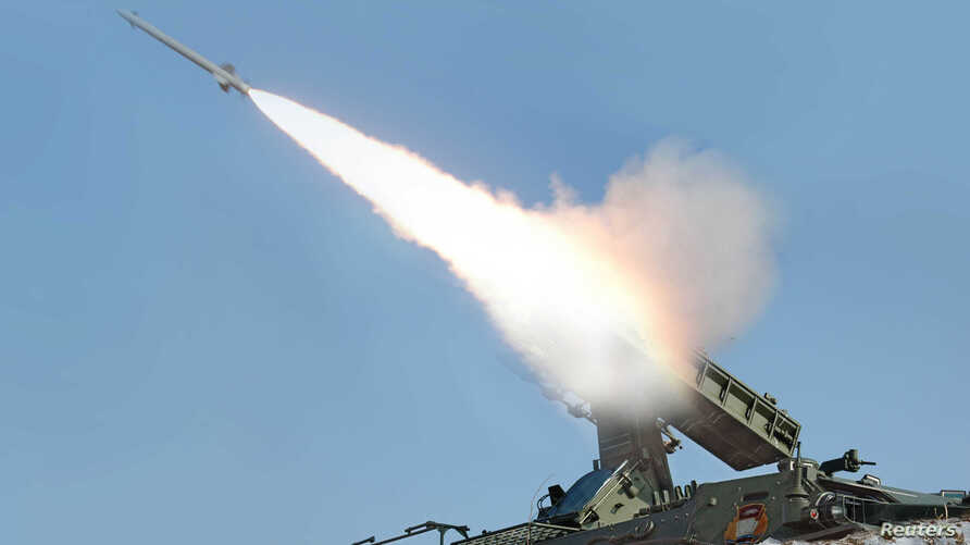 FILE - A rocket is fired during a drill of drone planes assaulting targets and a firing drill of self-propelled flak rocket destroying enemy cruise missiles coming in attack in low altitude, conducted by the air force and air defence artillery units