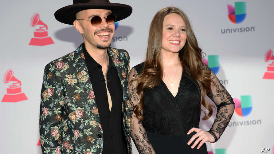 FILE - Jesse Huerta and Joy Huerta, of Jesse & Joy, arrive at the 16th annual Latin Grammy Awards in Las Vegas, Nov. 19, 2015. The duo was nominated for four Latin Grammys, Sept. 21, 2016.