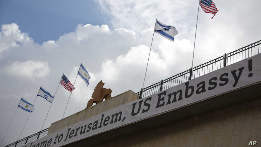 A sign on a bridge leading to the U.S. Embassy compound ahead the official opening in Jerusalem, May 13, 2018.