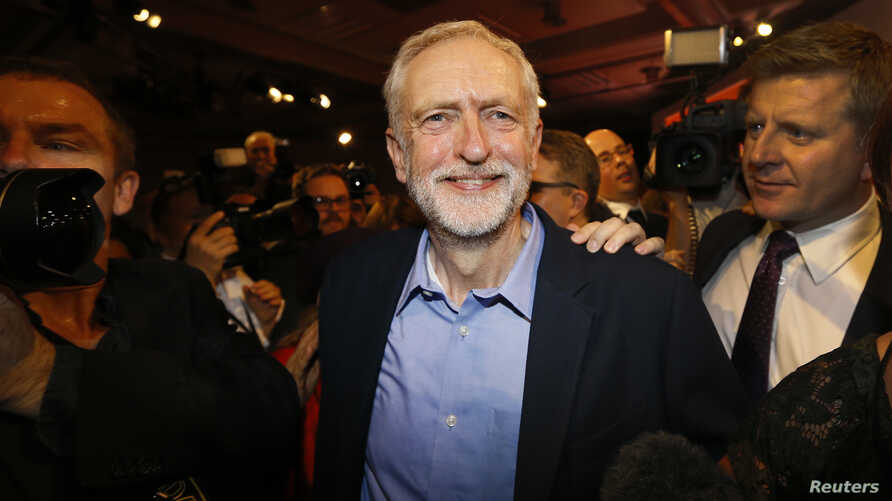 Jeremy Corbyn smiles as he leaves the stage after he is announced as the new leader of the Labor Party during the Labor Party Leadership Conference in London, Sept. 12, 2015.