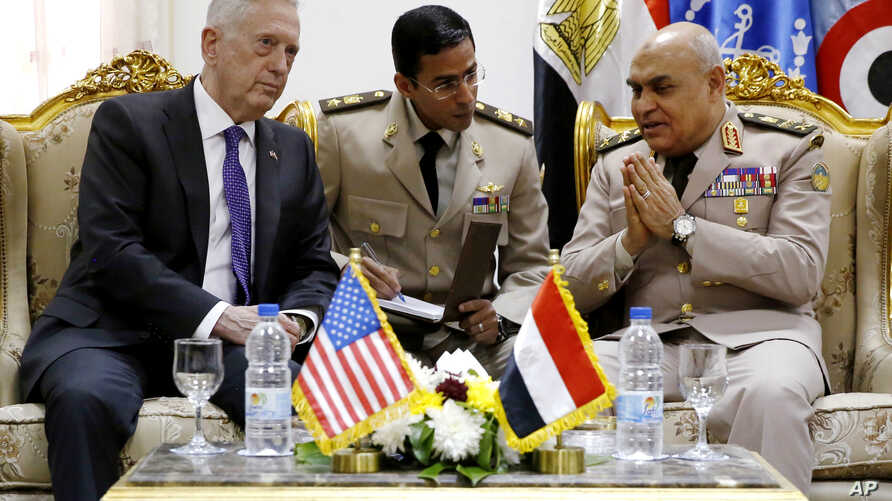 Egyptian Minister of Defense Sedki Sobhi (right) meets with U.S. Defense Secretary James Mattis (left) upon his arrival at Cairo International Airport in Cairo, April 20, 2017.