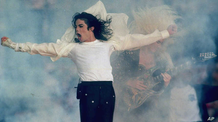 FILE - Michael Jackson performs during the halftime show at the Super Bowl XXVII in Pasadena, Calif., Jan. 31, 1993.