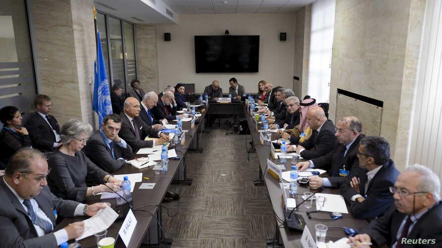 FILE - General view during a meeting between U.N. Syria envoy Staffan de Mistura and members of the Syrian interior opposition during Syria peace talks at the United Nations Office.