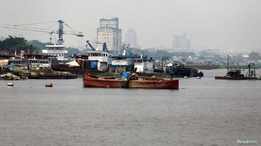 FILE - Fishing vessels are seen docked along the Congo River in the Democratic Republic of Congo's capital Kinshasa, Dec. 21, 2016.