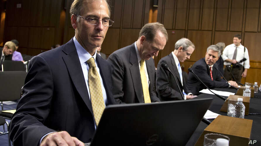FILE - Mark Zandi, chief economist with Moody's Analytics testifies at a Joint Economic Committee hearing on Capitol Hill in Washington