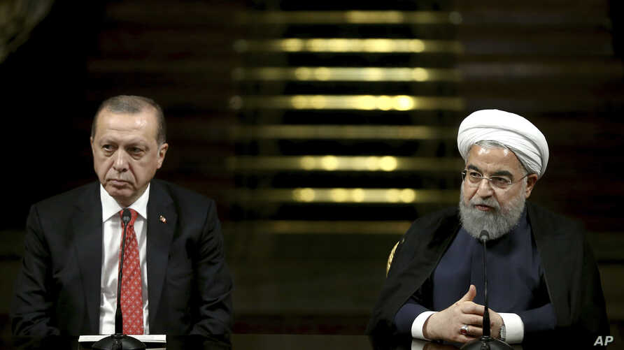 Iranian President Hassan Rouhani, right, speaks with media during a joint press conference with Turkish President Recep Tayyip Erdogan after their meeting at the Saadabad Palace in Tehran, Iran, Oct. 4, 2017.