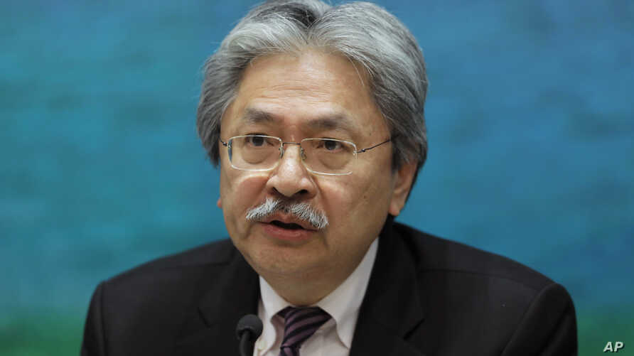 FILE - In this Nov. 4, 2016 file photo, Financial Secretary John Tsang speaks during a press conference at the government headquarters in Hong Kong.