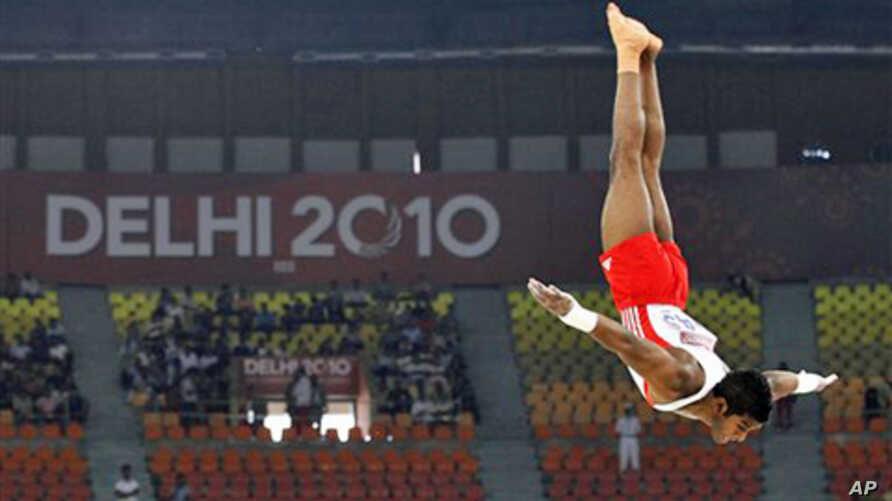 William Albert of Trinidad and Tobago performs in the floor exercise in the gymnastics team final during the Commonwealth Games in New Delhi, India, Monday, Oct. 4, 2010.