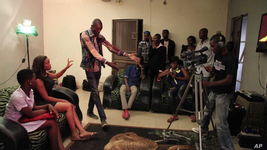 File - Nollywood actors perform a scene for a movie in Lagos, Nigeria.