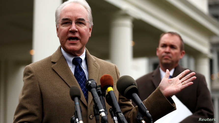 U.S. Secretary of Health and Human Services (HHS) Tom Price, left, and Office of Management and Budget (OMB) Director Mick Mulvaney speak to reporters after the Congressional Budget Office released its score on proposed Republican health care legisla