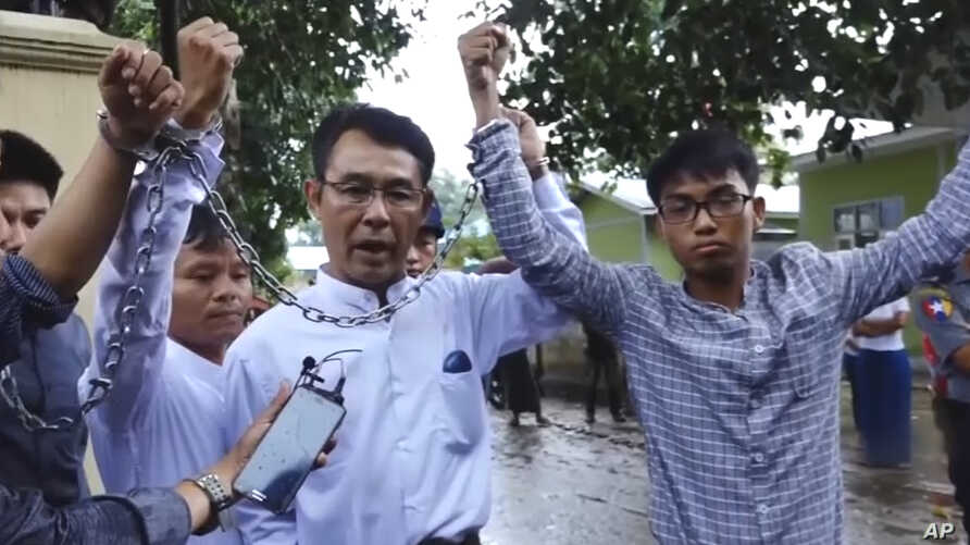 FILE - Image made from video released by the Democratic Voice of Burma July 18, 2017 shows (L-R) Burmese journalists  Lawi Weng, from the Irrawaddy, Aye Nai, from the Democratic Voice of Burma, and Pyae Bone Naing, from the Democratic Voice of Burma ...