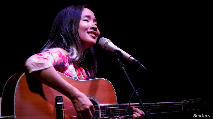 FILE - Vietnamese singer Do Nguyen Mai Khoi sings at a performance in Hanoi, May 21, 2016.