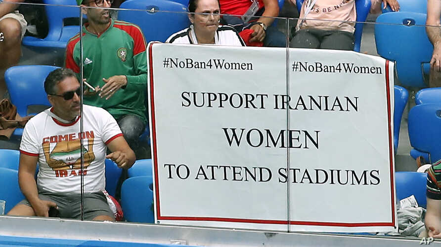 A poster to support Iranian women is displayed in the stands during the group B match between Morocco and Iran at the 2018 soccer World Cup in the St. Petersburg Stadium in St. Petersburg, Russia, June 15, 2018.
