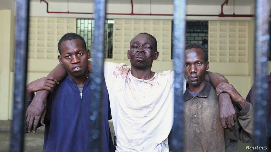 Omar Mwamnuadzi (C), leader of the separatist Mombasa Republican Council (MRC) arrives at the law court cells with members of the group at Kenya's Coastal region October 15, 2012.