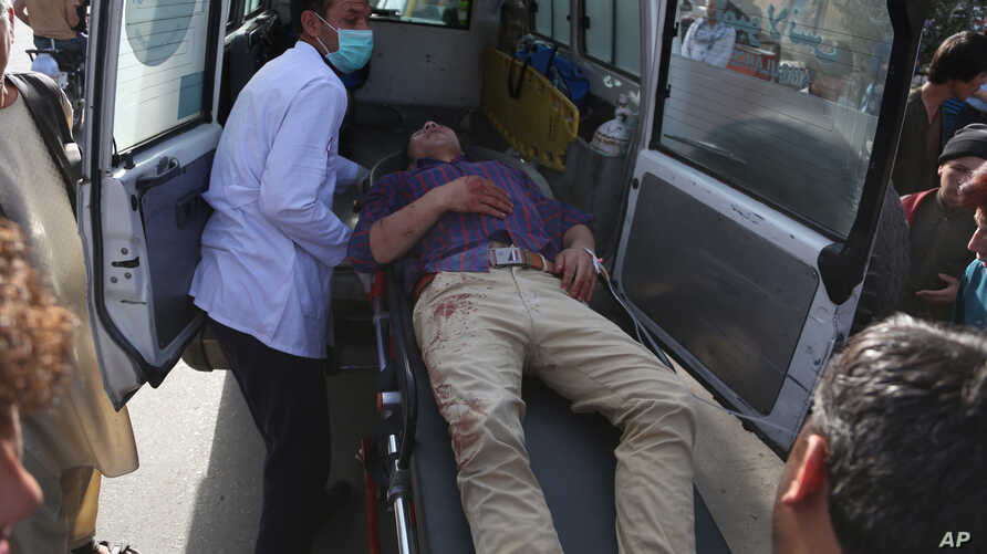 A man who was injured in a deadly suicide bombing that targeted a training class in a private building in the Shiite neighbourhood of Dasht-i Barcha, is placed in an ambulance in western Kabul, Afghanistan, Wednesday, Aug. 15, 2018.