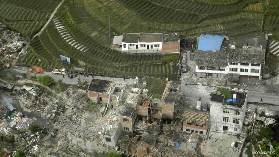 An aerial view shows houses damaged after a strong earthquake in Lushan county, Ya'an, Sichuan province, Apr. 20, 2013.
