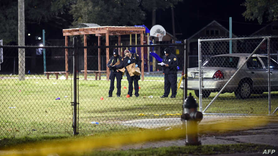 Police gather evidence after a shooting at a playground on Nov. 22, 2015 in New Orleans, Louisiana.