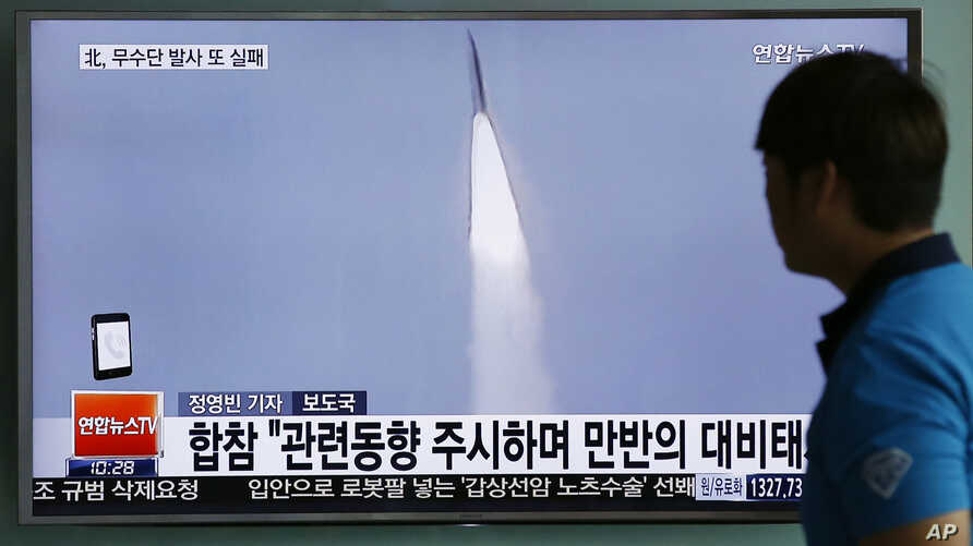 FILE - In this May 31, 2016, file photo, a man watches a TV news program reporting about a missile launch of North Korea, at the Seoul Train Station in Seoul, South Korea.