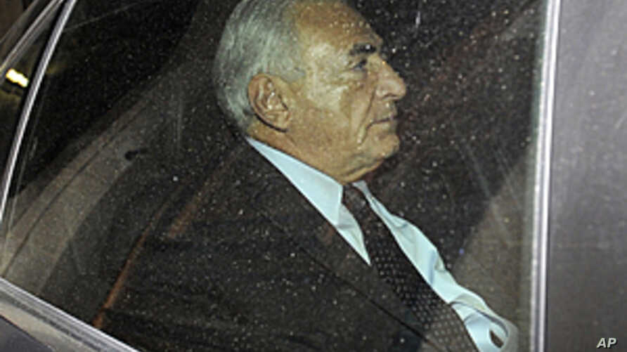 Former IMF chief Dominique Strauss-Kahn leaves his home on his way to a police station to confront a writer who accuses him of attempted rape, in Paris, France, Sept. 29, 2011.
