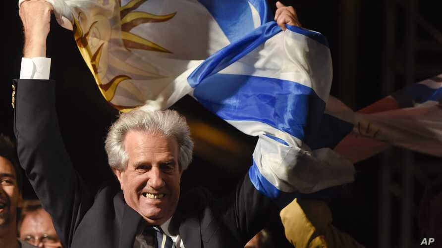 Presidential candidate for the ruling Broad Front party Tabare Vazquez celebrates in Montevideo, Uruguay, Nov. 30, 2014.