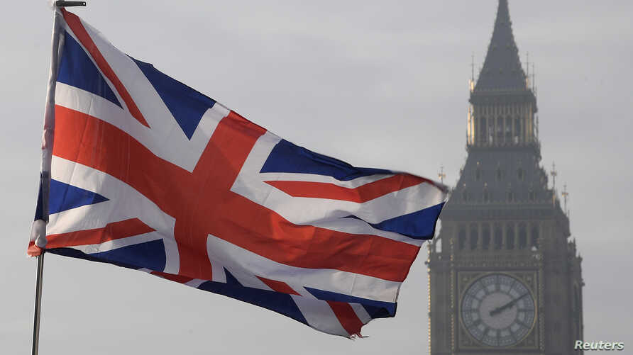 A Union flag flies in front of the Big Ben clock tower in London, Britain, Jan. 23, 2017.