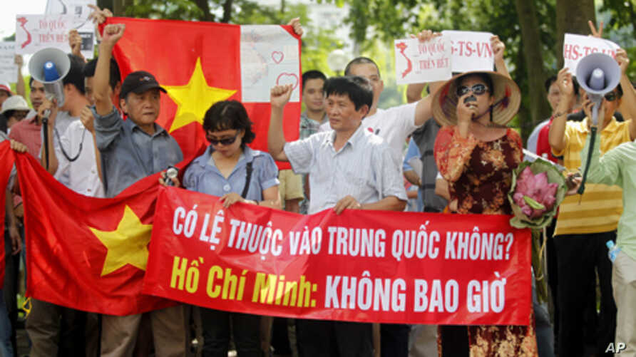Protesters chant anti-China slogans during a demonstration in front of Hanoi Moi newspaper, a local daily of Vietnam's Communist Party, in Hanoi  Aug. 14, 2011.
