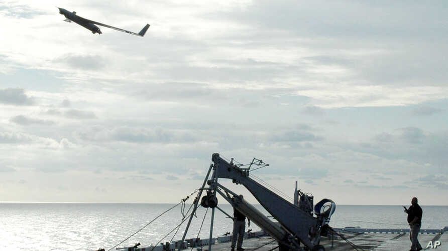 A Scan Eagle unmanned aerial vehicle launches from the flight deck of an amphibious assault ship. (File)