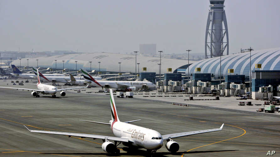 FILE - An Emirates airline passenger jet taxis on the tarmac at Dubai International airport in Dubai, United Arab Emirates.