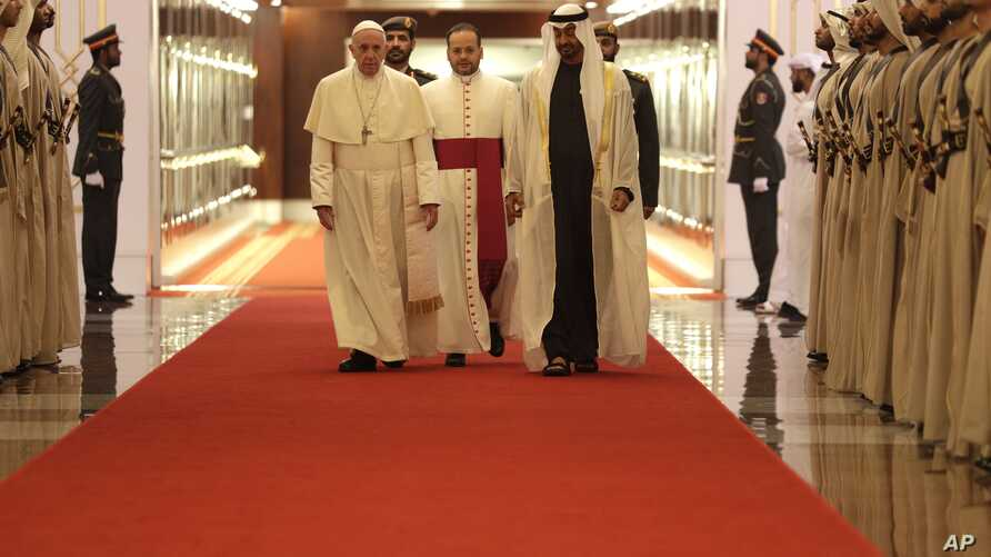 Pope Francis is welcomed by Abu Dhabi's Crown Prince Sheikh Mohammed bin Zayed Al Nahyan, upon his arrival at the Abu Dhabi airport, United Arab Emirates, Feb. 3, 2019.