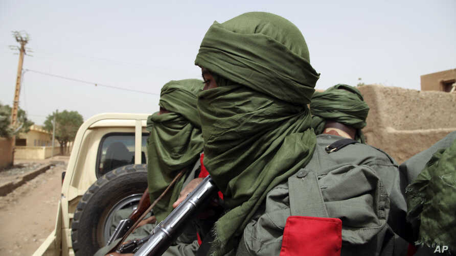 Malian troops join with former rebels during a joint patrol in Gao, Mali, Feb. 23, 2017. Malian soldiers and former Tuareg rebels have staged their first joint patrol in northern Mali, a key step in a 2015 peace agreement.