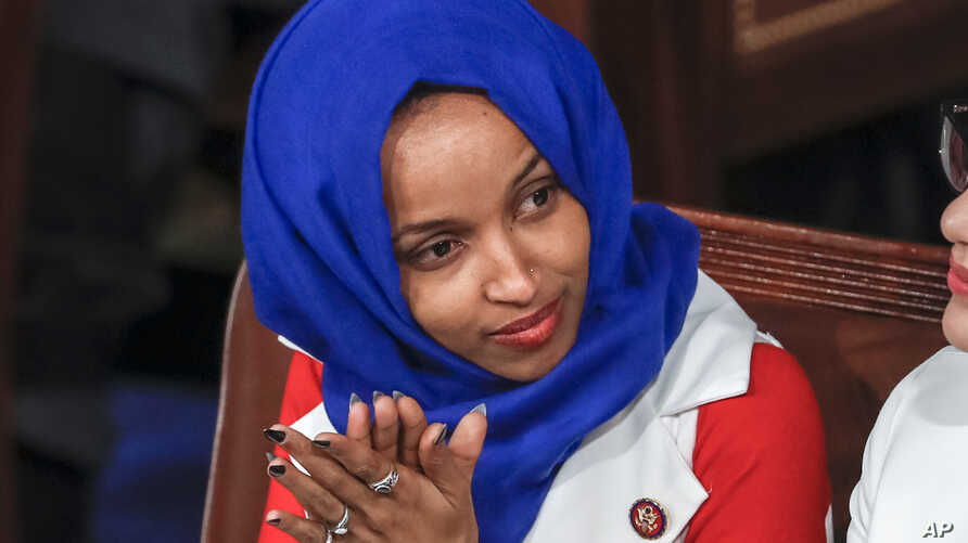 In this Feb. 5, 2019, file photo, Rep. Ilhan Omar, D-Minn., listens to President Donald Trump's State of the Union speech, at the Capitol in Washington.