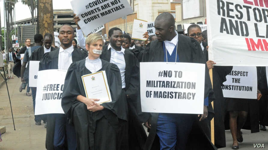 Lawyers are seen outside the Constitutional Court after they presented a petition to the country's chief justice Luke Malaba's office in Harare, Zimbabwe, Jan. 29, 2019.