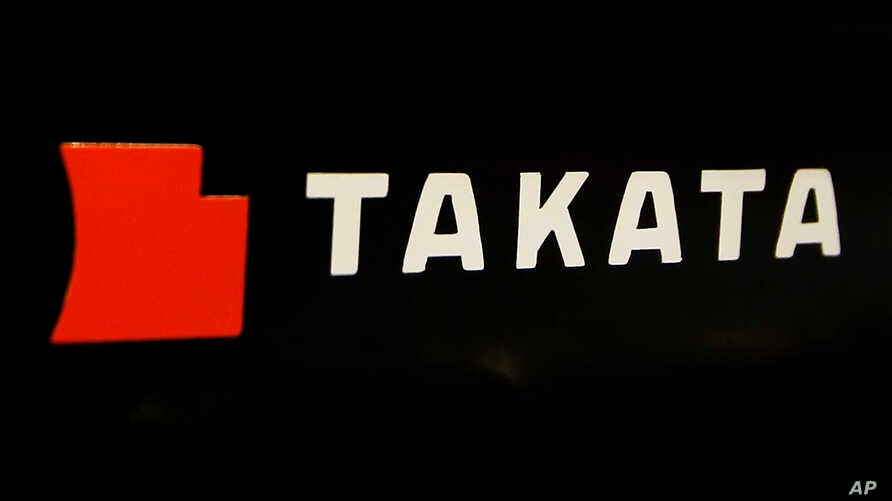 FILE - The logo of Takata Corp. is displayed at an auto supply shop in Tokyo.