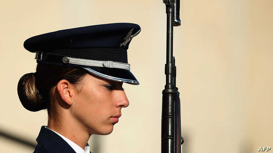 FILE - A female U.S. Air Force Airman First Class is part of an honor cordon that welcomed Qatar Minister of State for Defense Affairs Hamad bin Ali Al Attiyah to the Pentagon October 23, 2015 in Arlington, Virginia.
