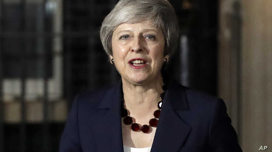 Britain's Prime Minister Theresa May delivers a speech outside 10 Downing Street in London, Nov. 14, 2018.