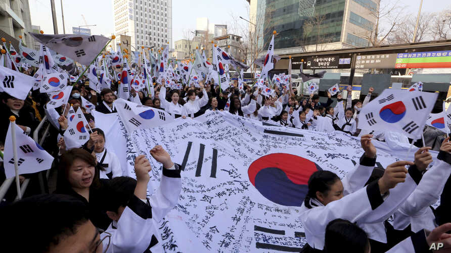 South Koreans give three cheers for the country as they march during a rally to mark the centennial of the March First Independence Movement Day against Japanese colonial rule (1910-45), in Seoul, South Korea, March 1, 2019.