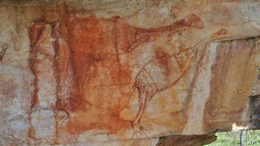 This undated archaeologist Ben Gunn handout photo received on May 31, 2010 shows an Aboriginal rock painting found in Australia's Arnhem Land; The red ochre painting shows two emu-like birds with their necks outstretched which are believed to show th