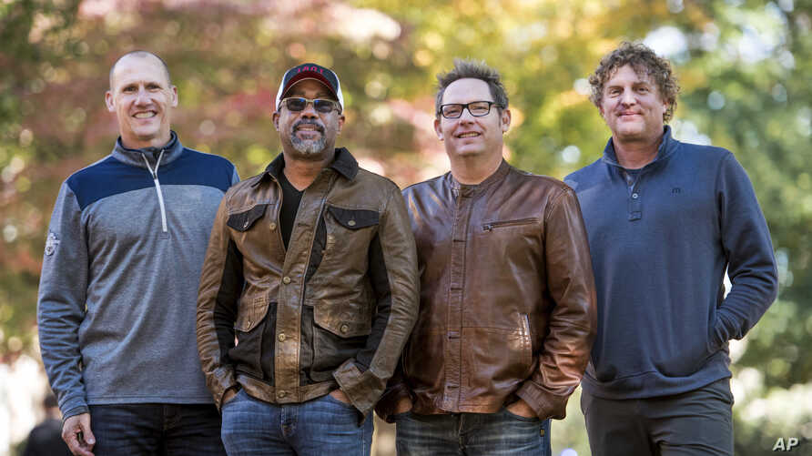 Jim Sonefeld, from left, Darius Rucker, Dean Felber, and Mark Bryan, of Hootie & the Blowfish, pose for a portrait at the University of South Carolina in Columbia, S.C., Nov. 16, 2018.